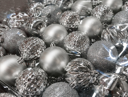 stock photo variety of silver christmas balls in clear transparent plastic package selective focus