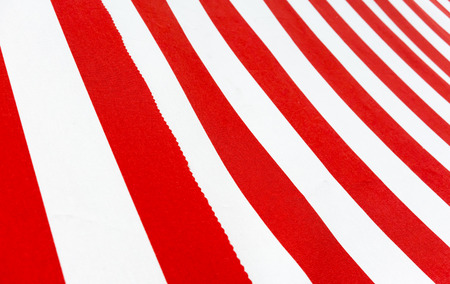 Red and White striped canvas from lower angle for seamless background.