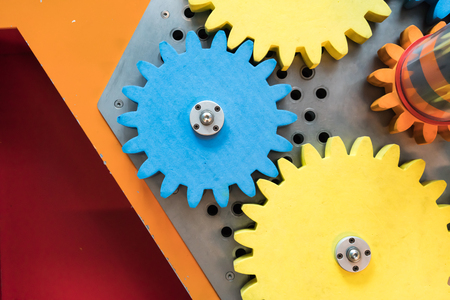basic scheme: Colorful wooden gears with twisting bar for kid activity and learning on mechanical engineering basic.