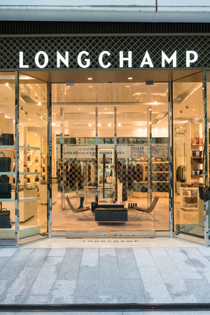 Longchamp shop at Emquatier, Bangkok, Thailand, Oct 15, 2017 : Luxury and fashionable brand visual merchandised idea. New collection of fashion bags display.