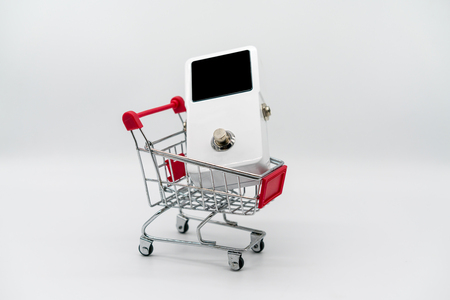 White guitar pedal and red shopping cart isolated on white background Stock Photo