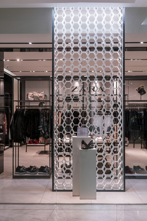 Zara shop at Emquatier, Bangkok, Thailand, Jan 6, 2018 : Zara accessories window display. Luxury and fashionable leather shoe and bag against pattern wall.