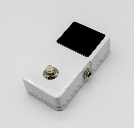 White guitar pedal effect, Strompbox, with big LED screen display isolated on white background Stock Photo