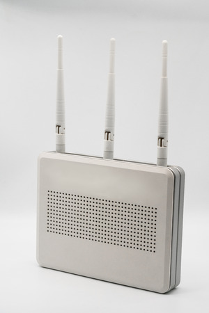 WiFi wireless router with three antenna isolated on white background Stock Photo