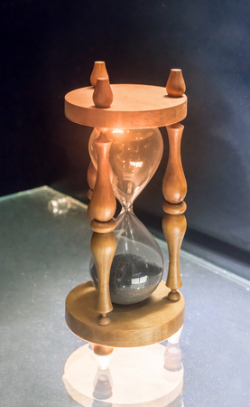 Sandglass or Sand Watch as time passing concept for business deadline, urgency and running out of time.