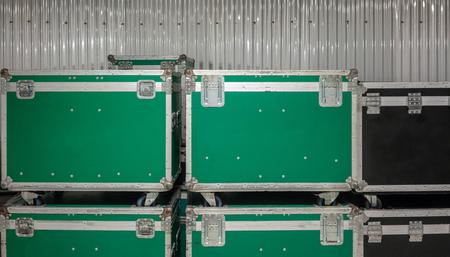 Set of green and black aluminium wooden flight cases. Musical instrument cases.