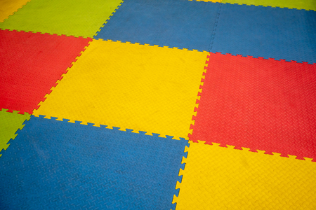 Rubber foam for baby play and childhood background. Colorful Baby Mat. Stock Photo