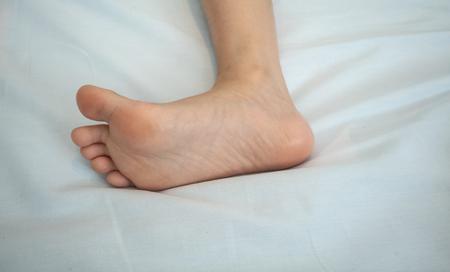 Children's foot. Child's foot on white background