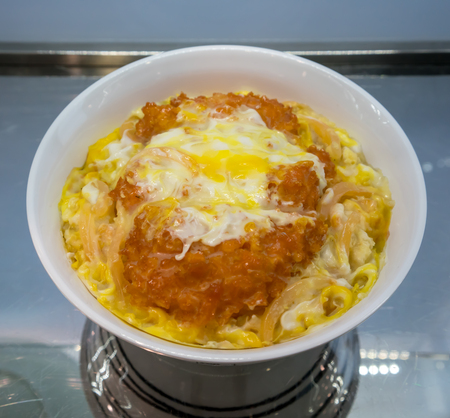 A look through cabinet mirror of Japanese pork cutlet katsudon model for food presentation and shop decoration.