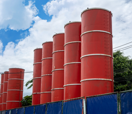 Water containers or road industrial gases, construction waiting to be set up.
