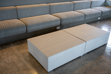 Woven wicker seamless pattern square tables on concrete floor in living room