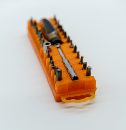 Set of heads for screwdriver (bits) Tools collection in orange plastic packaging isolated on white background 写真素材