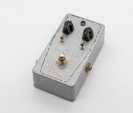 Silver texture vintage guitar pedal isolated on white background