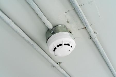 Smoke detector sensor on cement ceiling in parking area Stock fotó