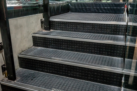 Non-slip stairs with dot pattern close up for background. A black rubber stairs. 版權商用圖片