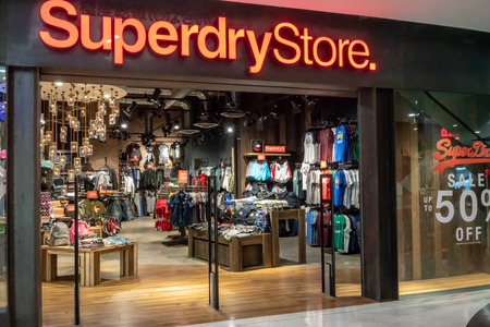 Superdry shop at Emquatier, Bangkok, Thailand, Jun 29, 2018 : Luxury and fashionable sportswear brand display and interior from entrance with shoplifting detector. Éditoriale