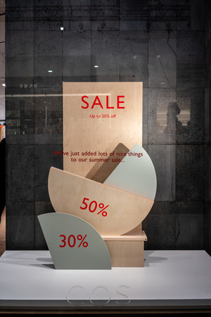 COS shop at Emquatier, Bangkok, Thailand, Jun 29, 2018 : Attractive sales display with info graphic composition at fashionable and modern clothing brand.