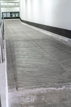 Concrete ramp or stucco cement pathway for wheelchair or cart Imagens