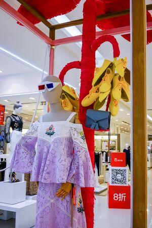Visual merchandising at Siam Paragon, Bangkok, Thailand, May 9, 2018 : Fashionable clothing brand display at the shopping mall. Editorial