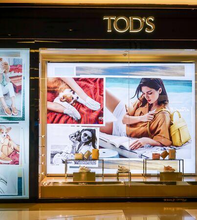 TOD's shop at at Siam Paragon, Bangkok, Thailand, May 9, 2018 : Luxury gold interior of fashionable bags and shoe brand window display..