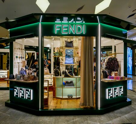 Fendi shop at Siam Paragon, Bangkok, Thailand, May 9, 2018 : Luxury fashion leather goods and clothing isle shop with window display at flagship store. Redactioneel