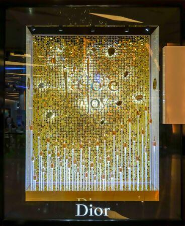 Dior shop at Siam Paragon, Bangkok, Thailand, May 9, 2018 : Jadore perfume window display with luxury look in gold.