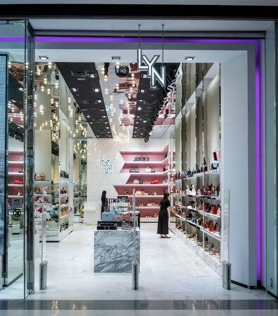 Lyn shop at Central Westgate Bangkok, Thailand, May 10, 2018 : Fashionable brand of Bags and Shoes interior and decoration. Front view from entrance.