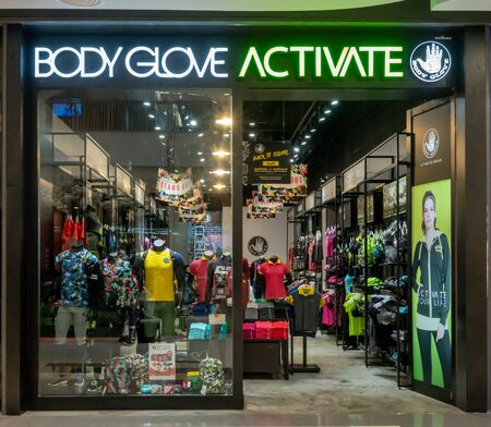 Body Glove Activate shop at Central Westgate Bangkok, Thailand, May 10, 2018 : Fashionable active wear brand window display. Front view from entrance. Éditoriale