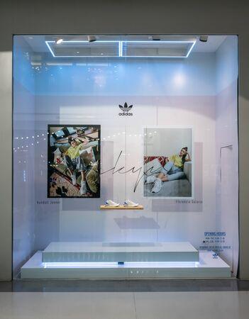 Adidas shop at Central Westgate Bangkok, Thailand, May 10, 2018 : Fashionable sportswear brand visual merchandising. Modern white design window display.