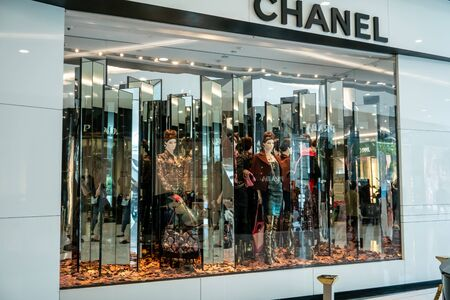 Chanel shop at Emquatier, Bangkok, Thailand, Oct 15, 2018 : Luxury and fashionable clothing brand window display. Showcase in Fall theme at flagship store. Éditoriale