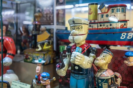 Suksasom museum at Phutthamonthon Sai 2, Bangkok, Thailand, 24 Sep, 2018 : Closed up antique tin Popeye toy model.