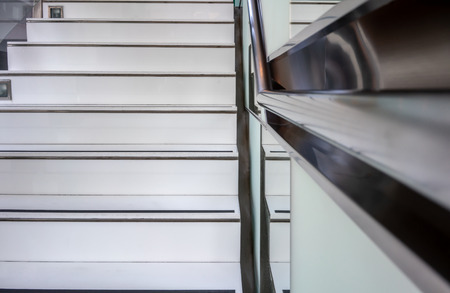 Abstract modern white stairs with non-slip line pattern  - stairway composition