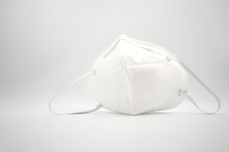 Disposal 3D air pollution or dust mask with adjustable metal noseclip isolated on white back ground and comfort strap.
