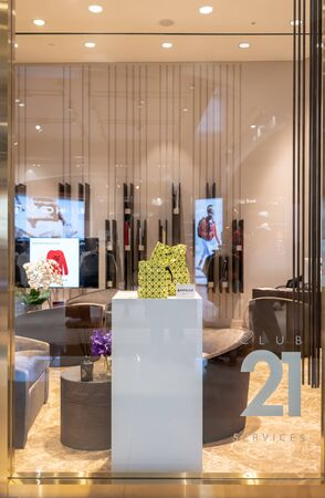 Executive lounge for Club 21 members at Emquatier, Bangkok, Thailand, Feb 3, 2019 : Entrance door golden decoration with fashionable brand name bag display.