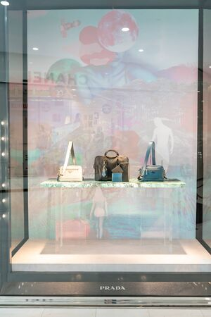 Prada shop at Emquatier, Bangkok, Thailand, Feb 3, 2019 : Luxury and fashionable brand of leather bags. Window display at flagship store. Editorial