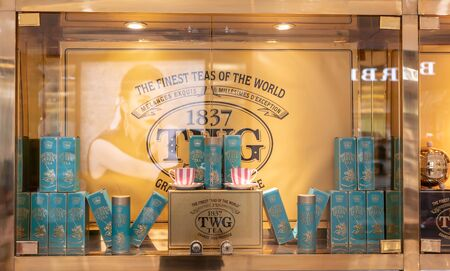 TWG tea salon and boutique cafe in Emporium shopping mall, Bangkok, Thailand, Feb 3, 2019 : Shop display with golden yellow decoration.