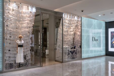 Dior shop at Emquatier, Bangkok, Thailand, Feb 3, 2019 : Attractive front store of luxury clothing brand window display with white lace pattern decoration. Editorial