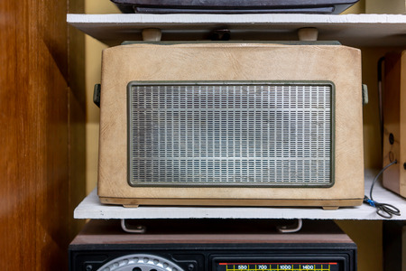 Vintage retro radio on wooden shelf. Retro technology and music concept. Stock fotó