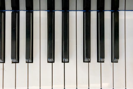 Close-up of the piano keys in top view. View from above.