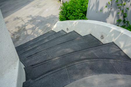 Curve modern concrete stairs with non-slip line pattern  - stairway composition