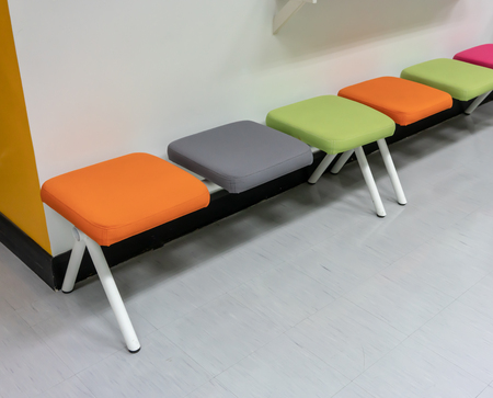 Colorful chairs with fabric cushion on white floor within rest area. 版權商用圖片