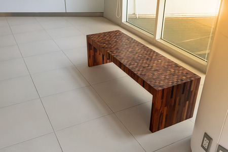 Modern wood chair in rest area. Modern office or house furniture. Wooden pattern for furniture