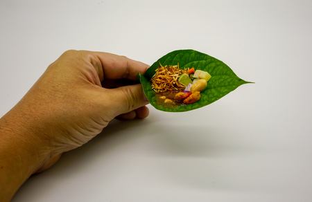 Thai traditional savory dessert. Food wrapped in leaves, a nutritious snack in Thailand. Stock Photo