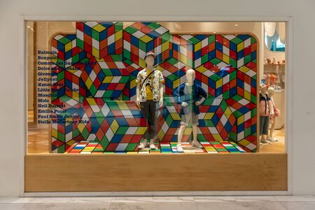Kids 21 shop at Emquartier Thailand, Apr 25, 2019 : Luxury and fashionable brand window display. Casual Kid clothings and modern interior with colorful background in front of the store.