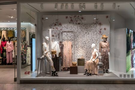 H&M shop at Emquatier, Bangkok, Thailand, Apr 25, 2019 : Unique H&M clothing with Morris & Co collaboration  window display for autumn collection.