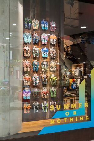 Superdry shop at Emquatier, Bangkok, Thailand, Apr 25, 2019 : Luxury and fashionable brand window display. New collection of flipflop showcase.