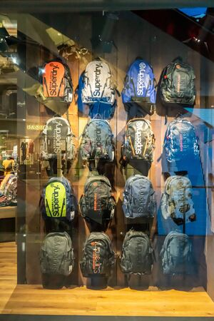 Superdry shop at Emquatier, Bangkok, Thailand, Apr 25, 2019 : Luxury and fashionable brand window display. New collection of bags showcase.