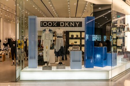 DKNY shop at Emquatier, Bangkok, Thailand, Apr 25, 2019 : Luxury and fashionable brand window display. New collection of clothings and bag showcase at flagship store.