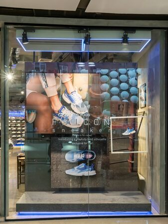 Adidas shop at Central Ladprao Bangkok, Thailand, June 23, 2019 : Fashionable sportswear brand visual merchandising. Modern design window display.