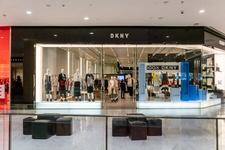 DKNY shop at Emquatier, Bangkok, Thailand, July 7, 2019 : Luxury and fashionable brand window display. New collection of clothings and bag showcase at flagship store. Editöryel